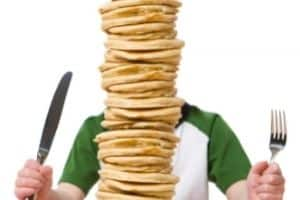 man with a big stack of pancakes