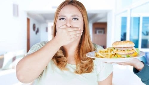 woman not eating snacks