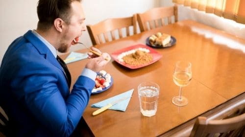 businessman eating at home